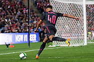 July 13 2017: Arsenal player Cohen Bramall (40) centres the ball at the International soccer match between English Premier League giants Arsenal and A-League premiers Sydney FC at ANZ Stadium in Sydney.