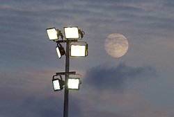 LLANELLI, WALES - Monday, August 19, 2013: A full moon passes the Stebonheath Park floodlights as England take on France during the Group A match of the UEFA Women's Under-19 Championship Wales 2013 tournament at Stebonheath Park. (Pic by David Rawcliffe/Propaganda)