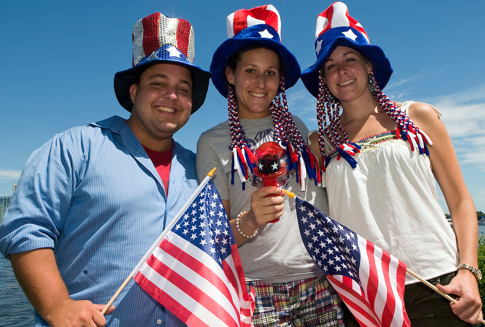 (070410, Boston, MA)..John Irvin, 24, of Wakefield, MA, Krista McMahon, 23, of Redding, MA, and Kate Wilson, 23, of Charlton, MA show their colors on the Esplanade on Sunday, July 4, 2010 in Boston, MA.  These fine people invited me into their palatial tent- good fun!..Staff Photo by Brooks Canaday..Saved in Monday