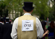 © Licensed to London News Pictures. 07/07/2012. London, UK  A competitor at 'The Chap's Olympiad' in central London on July 7th, 2012. 'The Chap' is a light-hearted magazine, aimed at revisiting the fashions and pastimes of the polite aspects of 1920's to 1950's England. The annual Olympiad event sees competitors take part in events such the 'Cucumber Sandwich Discus', 'The Umbrella Joust' and 'The Tug of Hair'e. Photo credit : Stephen Simpson/LNP