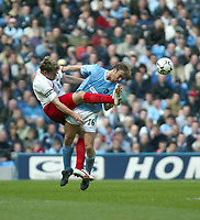 Photo. Andrew Unwin, Digitalsport.<br /> Manchester City v Southampton, FA Barclaycard Premier League, City of Manchester Stadium, Manchester 17/04/2004.<br /> Manchester City's Paul Bosvelt (r) goes in bravely against Southampton's James Beattie (l).