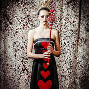 Fashion and fine art portraits photographed by Janelle Pietrzak aka Explored Exposure - model Tatiana Ringsby, makeup by Mallee Gambuti. Images depict the Queen of Hearts from Lewis Carroll's, Alice in Wonderland.
