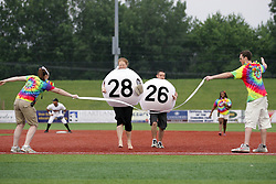09 June 2011: Lotto ball #28 wins a race from third to first during a game between the Lake Erie Crushers and the Normal Cornbelters at the Corn Crib in Normal Illinois.