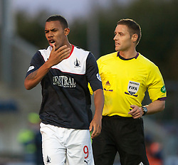 Falkirk's Phil Roberts with ref Steven McLean.<br /> Falkirk 2 v 1 Dunfermline, Scottish League Cup, 27/8/2013, at The Falkirk Stadium.<br /> &copy;Michael Schofield.