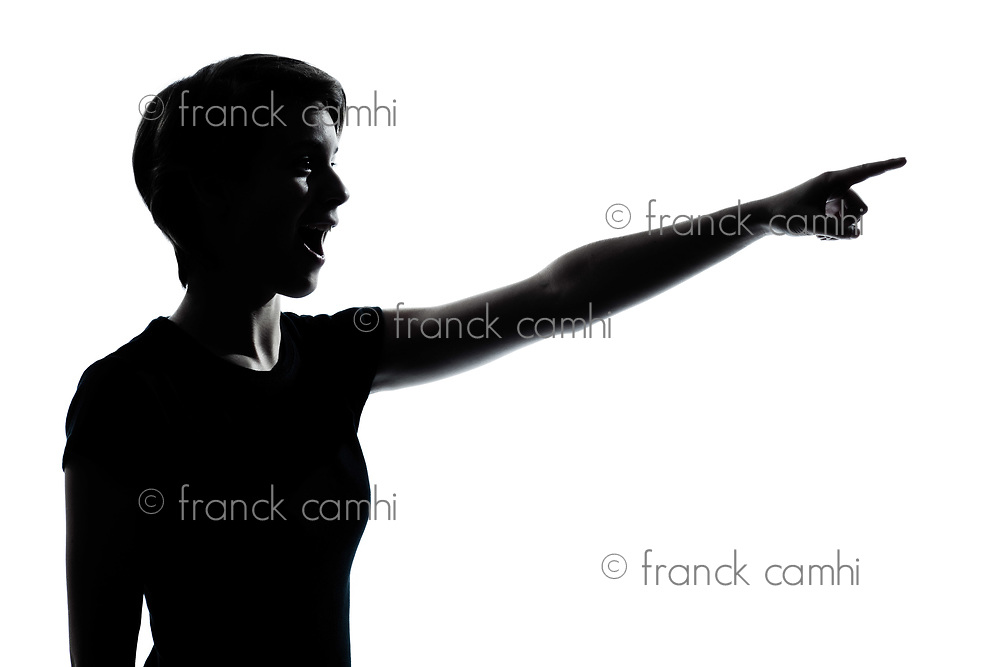 one caucasian young teenager silhouette girl pointing surprised  portrait in studio cut out isolated on white background