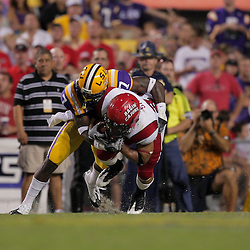 19 September 2009: LSU Tigers cornerback Patrick Peterson (7) hits Louisiana-Lafayette Cajuns running back Undrea Sails (31) after a reception during 31-3 win by the LSU Tigers over the University of Louisiana Lafayette Ragin' Cajuns at Tiger Stadium in Baton Rouge, Louisiana.