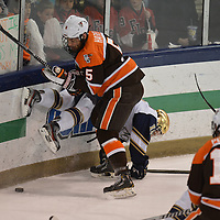 Bowling Green hockey  Rusty Hafner fights for the puck during the first period