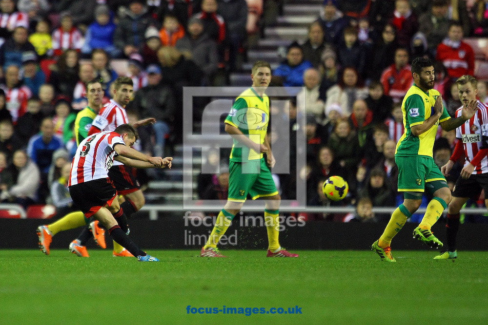 Picture by Paul Chesterton/Focus Images Ltd +44 7904 640267<br /> 21/12/2013<br /> Sunderland's Emanuele Giaccherini has a shot on goal during the Barclays Premier League match at the Stadium Of Light, Sunderland.