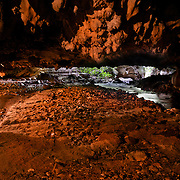 Tham Lod Noi Cave in Chaloem Rattanakosin National Park is the smallest park in Kanchanaburi Province, Thailand. To access the main valley of the park one must travel through the Than Lod Noi Cave first. The stream flows through the cave all year round.