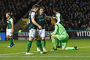 Substitute keeper Adam Bogdan gets a pat on the head for one of many vital saves he made during the Ladbrokes Scottish Premiership match between Hibernian and Rangers at Easter Road, Edinburgh, Scotland on 19 December 2018.