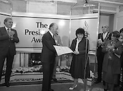 28/10/1985<br /> 10/28/1985<br /> 28 October 1985<br /> Launch of Gaisce The Presidents Award at Aras an Uachtarain. President Dr. Patrick Hillery launched the new national youth award scheme to be the nations highest award to Irish young people aged 15-25. Picture shows Mary Doherty (left) presenting her pledge to President Hillery. Mr John Murphy, Executive Director of the award in centre and Dr. Tony O'Reilly (2nd left) also feature in the image.