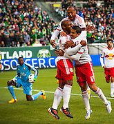 NY Red Bulls celebrate a goal by Fabian Espindola as Timbers goalkeeper Donovan Ricketts looks on. The MLS New York Red Bulls met the Portland Timbers in the Timbers regular season opener at Portland's JeldWen Field. The Timbers and the Red Bulls tied at 3-3.