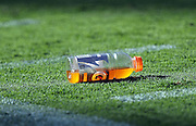 A drink bottle lies on the grass before the San Diego Chargers 2016 NFL preseason football game against the San Francisco 49ers on Thursday, Sept. 1, 2016 in San Diego. The 49ers won the game 31-21. (©Paul Anthony Spinelli)