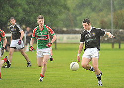 Kilmeena's Paul Groden and Ballina's Diarmuid Farrell in action during the junior Championship play-off.<br /> Pic Conor McKeown