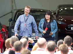 LONDON, ENGLAND - Saturday, June 7, 2014: The third UK owner of a Tesla Model S, 50 Shades of Grey author EL James with husband Niall Leonard, at the UK launch of Tesla Motors' Model S electric car at the Crystal. (Pic by David Rawcliffe/Propaganda)