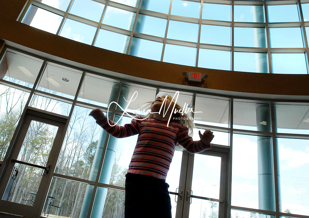 2/16/09 - Three-year-old Sarah spins, dances and twirls across the lobby of the new addition to the Morrison Family YMCA in Charlotte. Her mother, Gina , said, 'She's always singing and dancing'. The YMCA's expanded fitness center,  that just opened in January, made the perfect stage. L.MUELLER/The Charlotte Observer