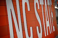 NC State brick logo on a wall in Talley Student Union.