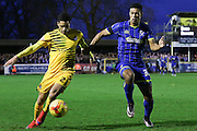 Lyle Taylor of AFC Wimbledon and Daniel Leadbitter of Bristol Rovers tussles during Sky Bet League 2 match between AFC Wimbledon and Bristol Rovers at the Cherry Red Records Stadium, Kingston, England on 26 December 2015. Photo by Stuart Butcher.