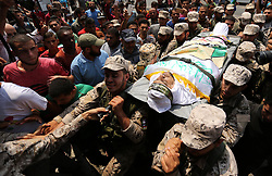August 17, 2017 - Rafah, Gaza Strip, Palestinian Territory - The body of a Palestinian security man is carried by his comrades during his funeral, in Rafah, southern Gaza Strip.  (Credit Image: © Ashraf Amra/APA Images via ZUMA Wire)