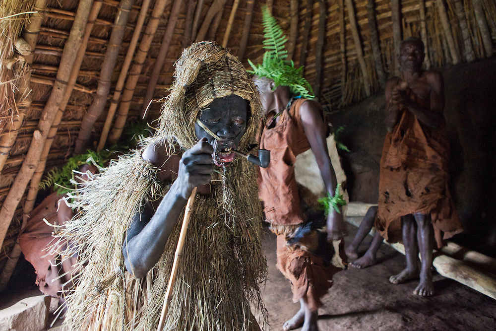 James and his fellow villagers are acting out a story about Nyabingi, the Batwa Deity in the village of Mukuno, Bwindi Impenetrable Forest in Uganda. They were indigenous forest nomads before they were evicted from the Bwindi Impenetrable Forest when it was made a World Heritage site to protect the mountain gorillas. The Batwa Development Program now supports them.