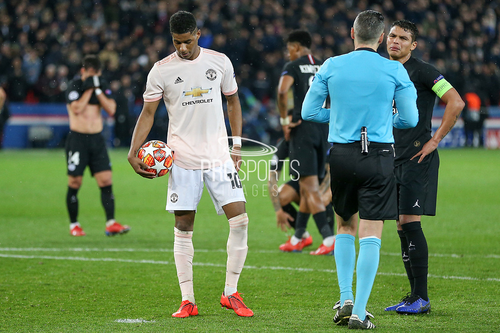 Thiago Silva of Paris Saint-Germain argues with Referee Damir Skomina of Slovenia as Manchester United Forward Marcus Rashford ready for penalty kick during the Champions League Round of 16 2nd leg match between Paris Saint-Germain and Manchester United at Parc des Princes, Paris, France on 6 March 2019.