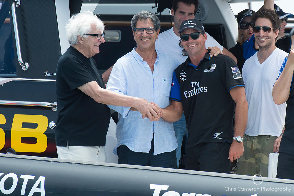 The Great Sound, Bermuda, 26th June 2017. Prada owner Patrizzio Bertelli, Yacht club commodore for Circolo Della Vela, Agostino Randazzo and Commodore for the Royal New Zealand Yacht Squadron Steve Mair shake hands as the new challenger of record and the holders of the America's Cup.