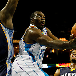 December 21, 2011; New Orleans, LA, USA; New Orleans Hornets small forward Quincy Pondexter (20) shoots past Memphis Grizzlies small forward Rudy Gay (22) and power forward Zach Randolph (50) during the first quarter of a preseason game at the New Orleans Arena.  The Hornets defeated the Grizzlies 95-80.  Mandatory Credit: Derick E. Hingle-US PRESSWIRE