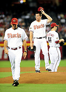 Sep. 20 2011; Phoenix, AZ, USA; Arizona Diamondbacks pitcher Daniel Hudson (41) reacts on the field after speaking with pitching coach Charles Nagy (50) while playing against the Pittsburgh Pirates at Chase Field. Mandatory Credit: Jennifer Stewart-US PRESSWIRE.