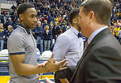 West Virginia Mountaineers guard Juwan Staten (3) talks with Oklahoma State Cowboys head coach Travis Ford after the game at the WVU Coliseum.