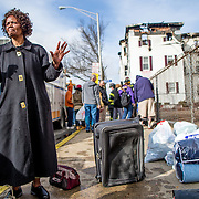03/25/2013  LYNN, MA    Building resident Zaina Saidi (cq) 60, stood with her belongings as firefighters were still at the scene after an overnight fire at her apartment building at 145 Lewis Street (cq) in Lynn.    (Aram Boghosian for The Boston Globe)
