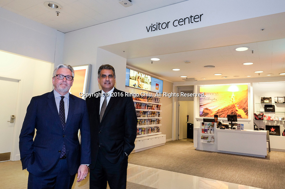 Henry Aguirre, right, and Michael Ellmann of Macy's in downtown Los Angeles.(Photo by Ringo Chiu/PHOTOFORMULA.com)<br /> <br /> Usage Notes: This content is intended for editorial use only. For other uses, additional clearances may be required.