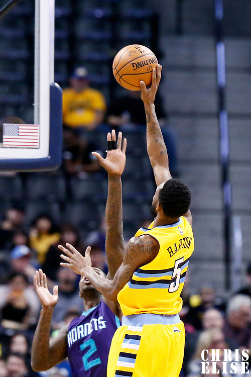 04 March 2017: Denver Nuggets guard Will Barton (5) goes for the baby hook over Charlotte Hornets forward Marvin Williams (2) during the Charlotte Hornets 112-102 victory over the Denver Nuggets, at the Pepsi Center, Denver, Colorado, USA.