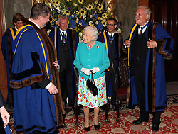 Queen Elizabeth II visits Drapers' Hall for a luncheon on the occasion of the 70th Anniversary of Her Majesty's Admission to the Freedom of the Company in London.
