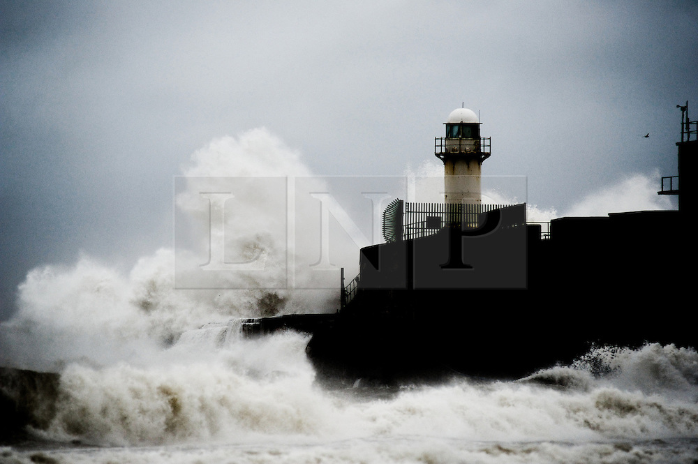 © Licensed to London News Pictures. 25/09/2012..Teesmouth, England..Waves crash against the lighthouse at South Gare on the mouth of the River Tees in Cleveland...Photo credit : Ian Forsyth/LNP