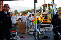 Salinas city workers, health officials and police conducted an early Thursday morning sweep of the Chinatown homeless population, removing encampments on the street and in lots between buildings all along Soledad Street. Although ample warning had been given by authorities, a number of homeless were displaced and have now scattered across the city. A fencing company moved in right behind the city's workers, digging postholes, and erecting chain link fencing in sections. Using a front loader, unclaimed possessions were taken away and disposed of over the course of three hours, leaving many people standing about on the street.