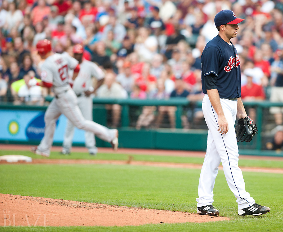 CLEVELAND, USA, JULY 5: Los Angeles Angels center fielder Mike Trout (27) rounds the bases on his three-run home run as Cleveland Indians starting pitcher Zach McAllister (34) reacts during the fifth inning at Progressive Field in Cleveland, OH, USA on Tuesday, July 3, 2012. .Photographer: Ken Blaze/Penta Press..