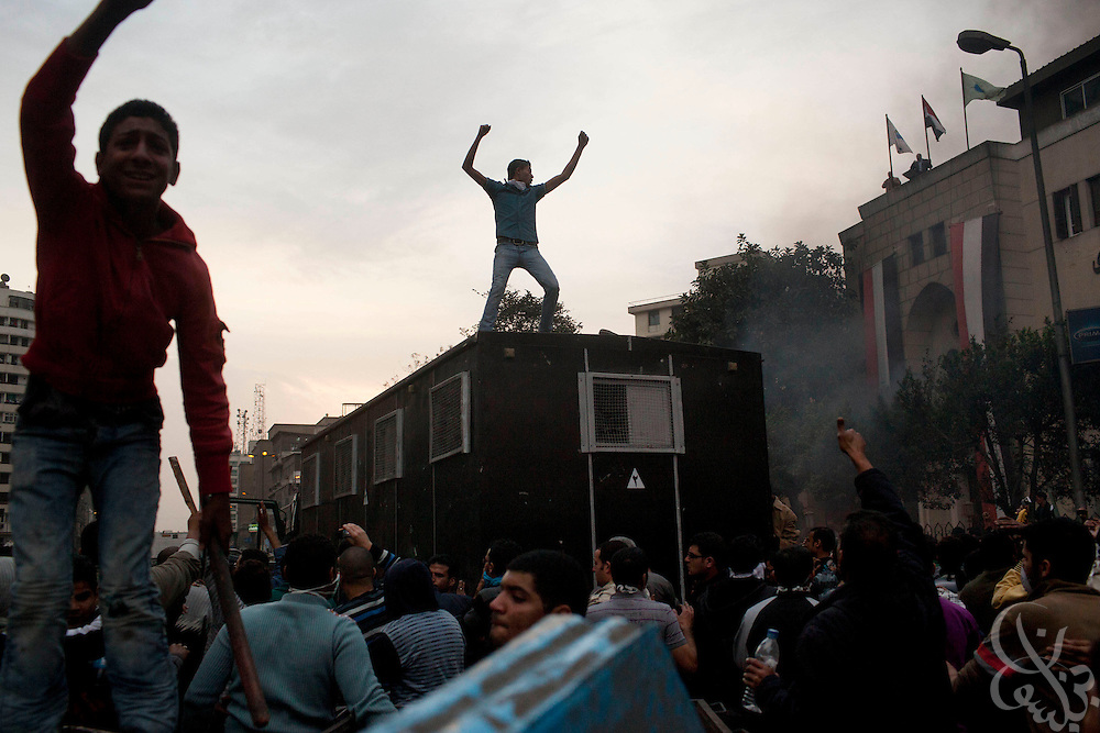Egyptian protesters celebrate atop a captured police troop carrier  on Ramsis street during massive and unprecedented demonstrations January 28, 2011 across Cairo, Egypt . The protests, inspired by the recent revolution in Tunisia, have struck a chord with Egypt's population, tired of inflation, high unemployment and alleged corruption within the Mubarak government..Slug: Egypt.Credit: Scott Nelson for the New York Times