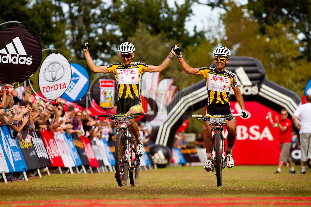 Overall winners Christoph Sauser and Burry Stander of 36One-Songo-Specialized during the final stage (stage 7 ) of the 2011 Absa Cape Epic Mountain Bike stage race held from Oak Valley to Lourensford, South Africa on the3rd April  2011...Photo by Sven Martin/Cape Epic/SPORTZPICS