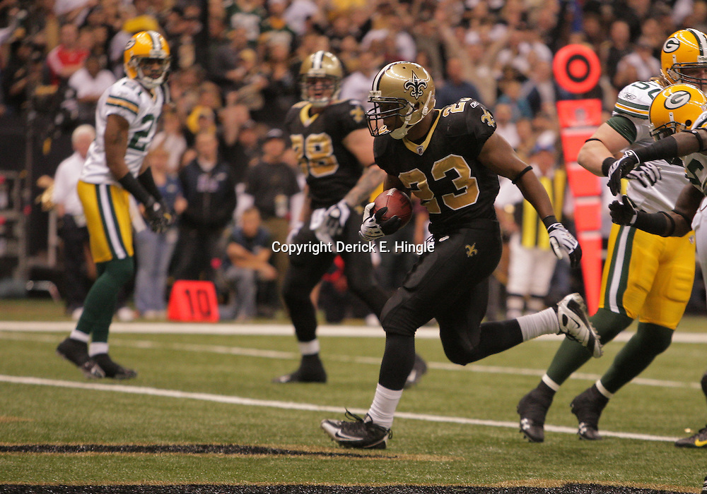 2008 November, 24: New Orleans Saints running back Pierre Thomas (23) bursts up the middle for a first half touchdown during a Monday Night Football game between the Green Bay Packers and the New Orleans Saints at the Louisiana Superdome in New Orleans, LA.