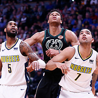 01 April 2018: Milwaukee Bucks forward Giannis Antetokounmpo (34) vies for the rebound with Denver Nuggets forward Will Barton (5) and Denver Nuggets forward Trey Lyles (7) during the Denver Nuggets 128-125 victory over the Milwaukee Bucks, at the Pepsi Center, Denver, Colorado, USA.