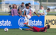 Portugal midfielder Diego Moreira (17) slide tackles into Team USA forward Osvaldo Reyes (7) during a CONCACAF boys under-15 championship soccer game, Saturday, August 10, 2019, in Bradenton, Fla. Portugal defeated Team USA 3-0 and advanced to the finals against Slovenia. (Kim Hukari/Image of Sport)