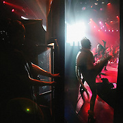 """Des danseurs sont photographiÈs depuis les coulisses le 16 Octobre 2006 au Lido ? Paris. Le """"plus cÈlËbre cabaret du monde"""", qui fÍte ses 60 ans jusquíen juillet 2007, prÈsente tous les soirs la revue """"Bonheur"""", ? laquelle participent 60 """"Bluebell Girls and Boys"""", selectionnÈs sur des critËres stricts : minimum 1,75m pour les danseuses et 1,83 m pour les danseurs. En coulisse le Lido, qui accueille un demi-million de clients et Ècoule 300.000 bouteilles de champagne par an - ce qui en fait le premier Ètablissement mondial consommateur de champagne - emploie prËs de 400 personnes. Une noria de techniciens, machinistes ou couturiers gr,ce ? qui, tous les soirs, la lÈgende du Lido se perpÈtue. ..Dancers are seen from backstage 16 october 2006 at """"Le Lido"""" in Paris. The famous French cabaret on the Champs-Elysees will celebrate its 60th anniversary until July 2007. 500,000 spectators a year enjoy the glamorous show performed by 60 strictly selected dancers - including 25 topless """"bluebell girls"""" -, whereas, in the wings, 400 stage technicians, mechanics and craftsmen help to make the legend comes true.   AFP PHOTO OLIVIER LABAN-MATTEI"""
