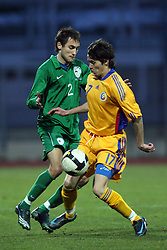 Ales Majer (2)  of Slovenia vs Catalin Doman of Romania during Friendly match between U-21 National teams of Slovenia and Romania, on February 11, 2009, in Nova Gorica, Slovenia. (Photo by Vid Ponikvar / Sportida)