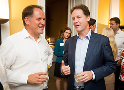 © Licensed to London News Pictures. 03/09/14. Admiralty House, Whitehall, London. Deputy Prime Minister Nick Clegg hosts a reception to celebrate his launch of the free school meals campaign, chatting with Henry Dimbleby, founder of Leon restaurant. Photo credit : David Tett/LNP
