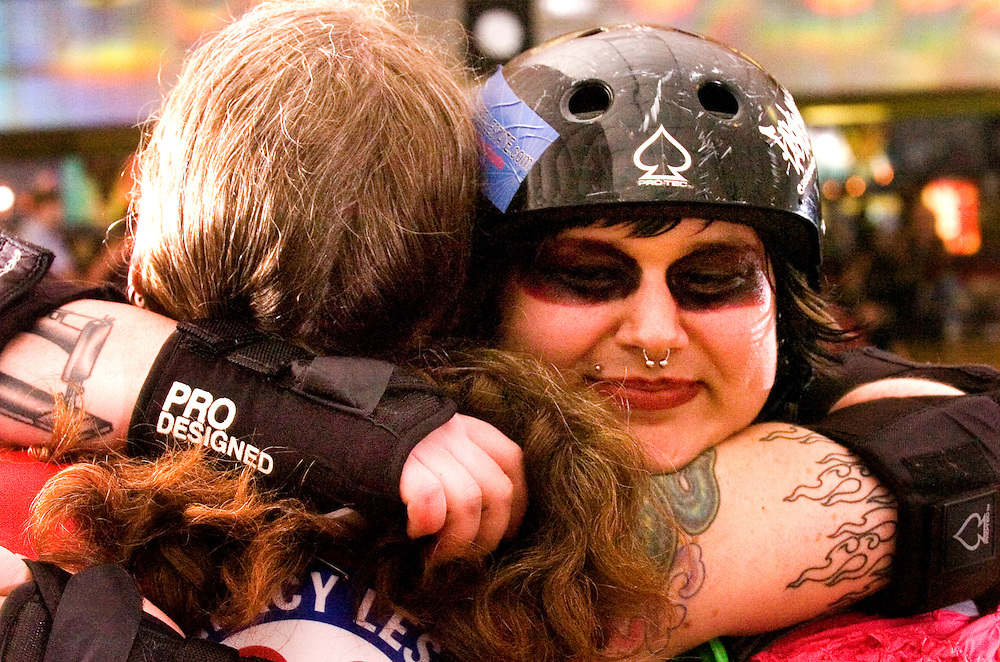 (Staff Photo by Matt Roth)..In front of a crowd of approximately 700 spectators, The Charm City Roller Girls brought pain during their Inaugural Bout at Putty Hill Skateland Sunday May 23, 2006. Speed Regime defeated the Junkyard Dolls 88-74 and the Mobtown Mods won over the Night Terrors 158-144.