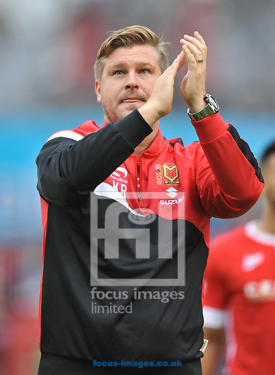 Karl Robinson Manager of Milton Keynes Dons celebrates with the fans after the Sky Bet League 1 match at Oakwell, Barnsley<br /> Picture by Richard Land/Focus Images Ltd +44 7713 507003<br /> 13/09/2014