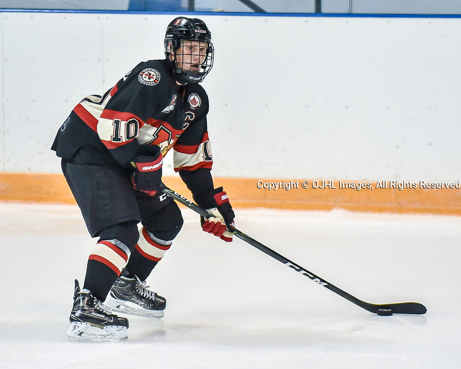 NEWMARKET, ON - SEP 14: Ontario Junior Hockey League game between the Newmarket Hurricanes and the Stouffville Spirit. Christian Dedonato #10 of the Newmarket Hurricanes skates with the puck.<br /> (Photo by Phillip Sutherland / OJHL Images)