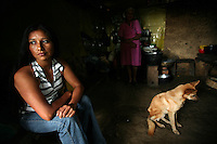 A woman sits inside her home in El Ofrio, a small remote village in the southern Colombian state of Nariño, on Saturday, June 23, 2007. There are coca fields located in the vicinity of El Ofrio, but the residents know that soon fumigation and manual eradication of their coca crops by the Colombian government will force them to find a new means to earn cash. (Photo/Scott Dalton)