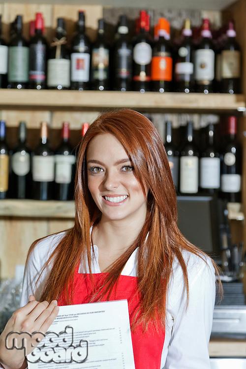 Portrait of a happy young waitress