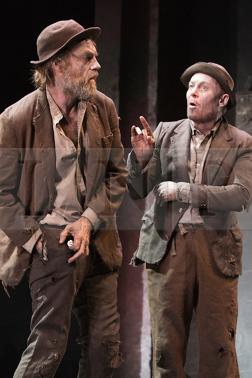 """© Licensed to London News Pictures. 05/06/2015. London, UK. L-R: Hugo Weaving as Vladimir and Richard Roxburgh as Estragon. Actors Richard Roxburgh and Hugo Weaving star in Samuel Beckett's """"Waiting for Godot"""" at the Barbican Theatre. Part of the International Beckett Season, this Sydney Theatre Company play is directed by Andrew Upton. With Luke Mullins as Luke, Philip Quast as Pozzo, Richard Roxburgh as Estragon and Hugo Weaving as Vladimir. Performances from 4 to 13 June 2015 at the Barbican Theatre. Photo credit : Bettina Strenske/LNP"""